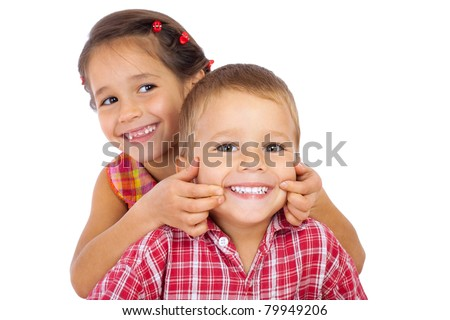 Two funny smiling little children, showing their teeth, isolated on white - stock photo