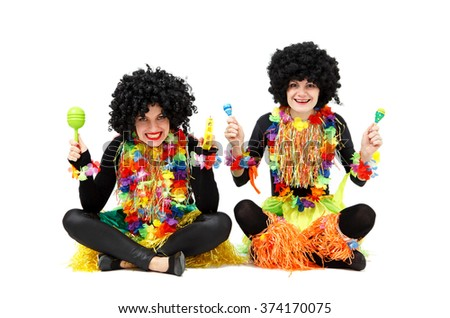 Two funny women in native costumes and wigs isolated on white - stock photo