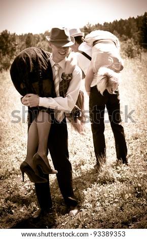Two gangsters steals women - stock photo