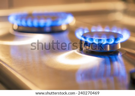 Two Gas Burners on Stove Surface. Horizontal Image - stock photo