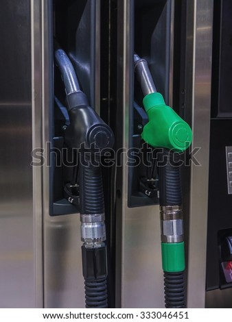 Two gas station pump nozzles for diesel and gasoline - stock photo