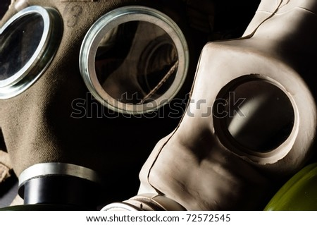 Two gasmask with focus on the grey one - stock photo