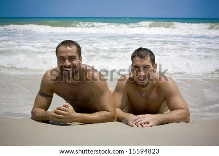 Two gay man at the beach - stock photo