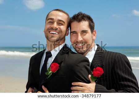 Two gay men after wedding on a beach - stock photo