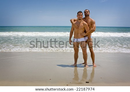 Two gay men at the beach - stock photo