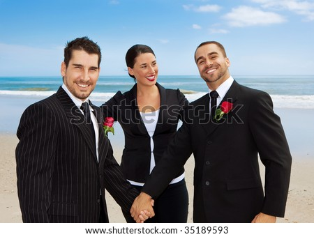 Two gay men getting married on a beach - stock photo