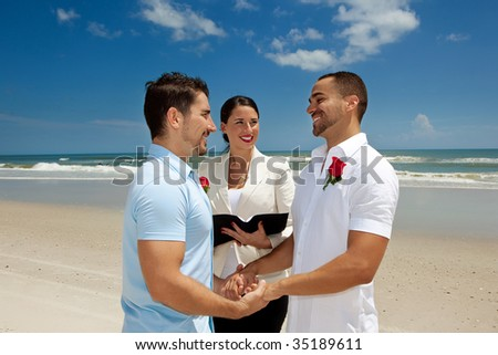 Two gay men married in wedding ceremony - stock photo