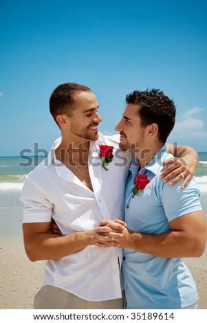 Two gay men standing on  a beach