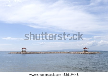 Two gazebo at the beach of Sanur, Bali, Indonesia - stock photo