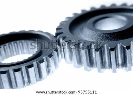 Two gears meshing together - stock photo
