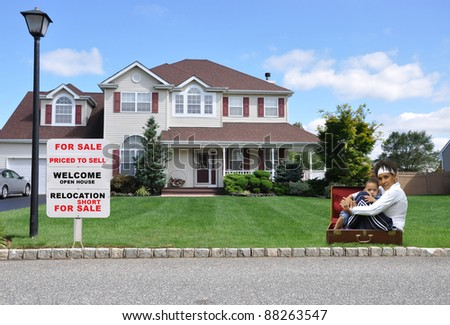 Two Generation Family Grandmother Grandson in Suitcase on Front Yard Lawn next to Realtor Relocation For Sale Sign - stock photo
