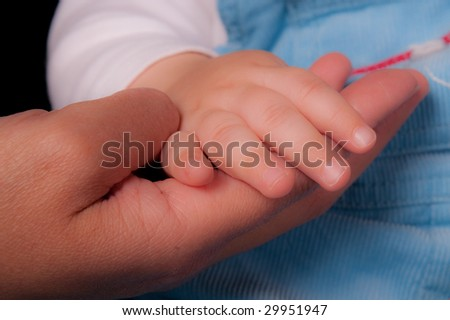 Two generations holding hands.