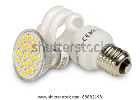 Two generations of light bulbs. - stock photo