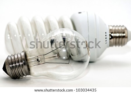 Two generations of light bulbs. Regular incandescent, energy saving fluorescent and LED isolated on white background with clipping path. - stock photo