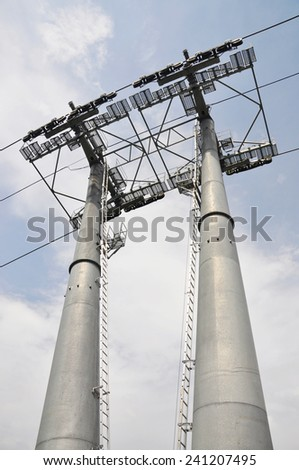 Two giant ski lift pillars, low angle view - stock photo