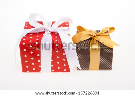 Two gift box Red and brown with dots with white and golden ribbon