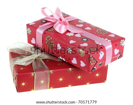 Two gift boxes which have been tied up by tapes with bows, isolated on a white background - stock photo