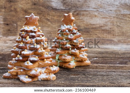 Two  gingerbread christmas trees on wooden background - stock photo