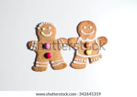 Two Gingerbread men, one with a missing leg, close-up