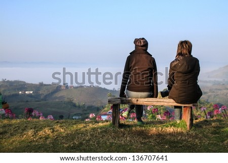 Two girl at Beautiful park garden in spring - stock photo