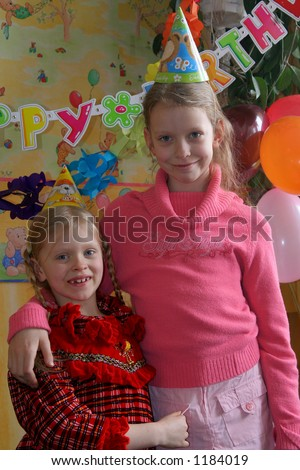 Two girl at the birthday party - stock photo