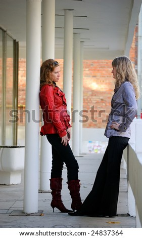 Two girl-friends about something argue - stock photo