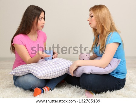 Two girl friends communicate on room