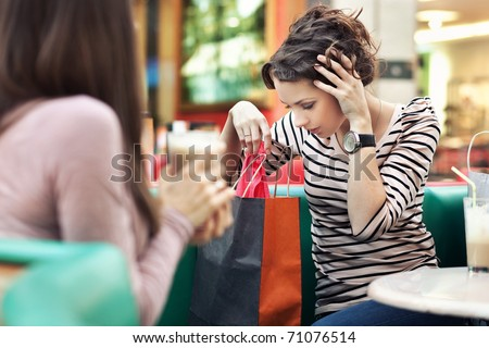 Two girl-friends on shopping