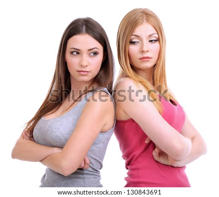 Two girl friends quarrel isolated on white - stock photo