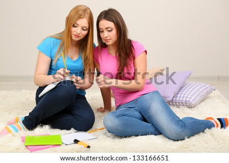 Two girl friends study on room