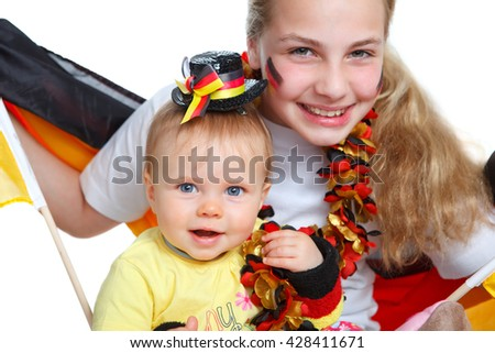 two girl jubilates with german flag for german team