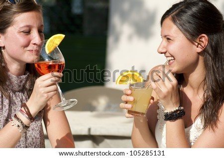 Two Girl While They Take a Cold Drink - stock photo