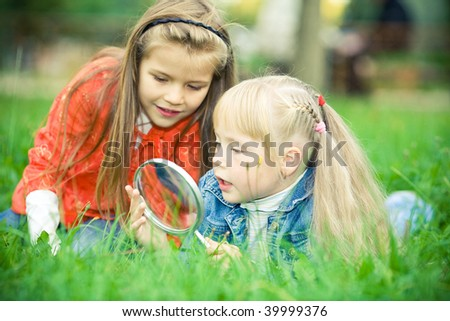 two girl with magnifier - stock photo