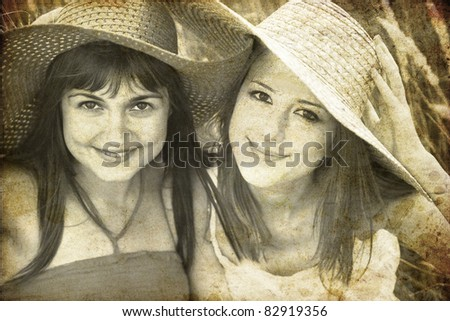 Two girlfriends at outdoor. Photo in old image style. - stock photo