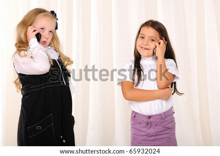 Two girlfriends chatting on the phone