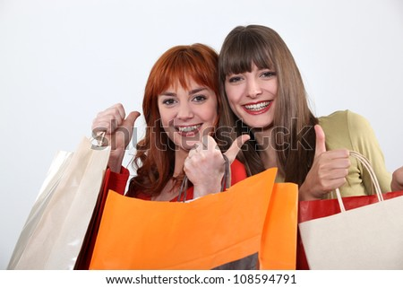 two girlfriends shopping together - stock photo