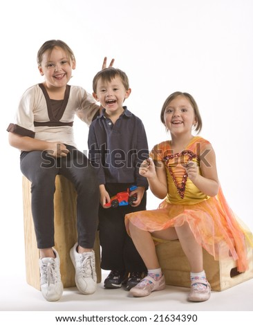 Two girls and their brother clowning around - stock photo