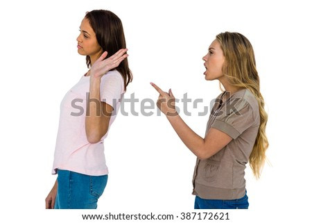 Two girls arguing pointing a finger and ignoring - stock photo