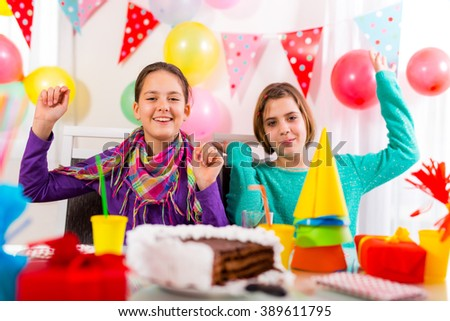 Two girls at birthday party having fun