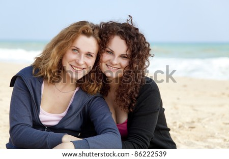 Two girls at outdoor near sea - stock photo