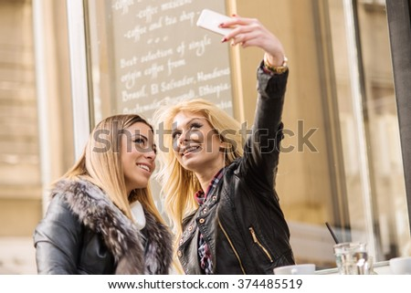 Two girls chatting at the coffee shop