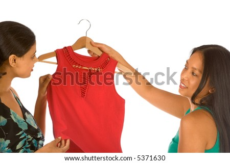 Two girls discussing purchasing of new red top - stock photo