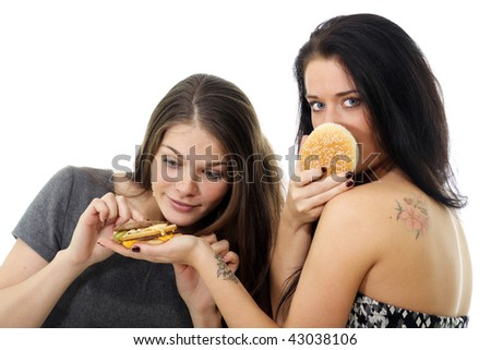 Two girls divide one sandwich