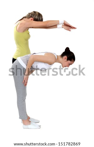 Two girls doing yoga - stock photo