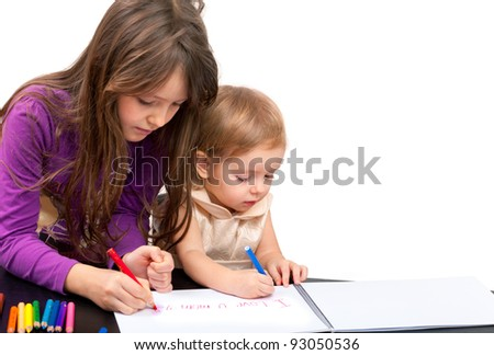 Two girls  drawing. Isolated on white - stock photo