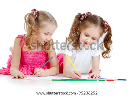 two girls drawing with color pencils together over white - stock photo