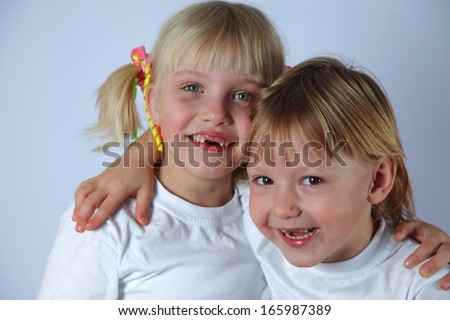 two girls embrace each other and smile - stock photo