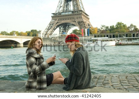 Two girls experience Paris as tourists.