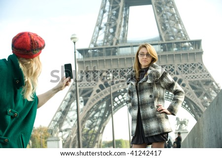 Two girls experience Paris as tourists. - stock photo