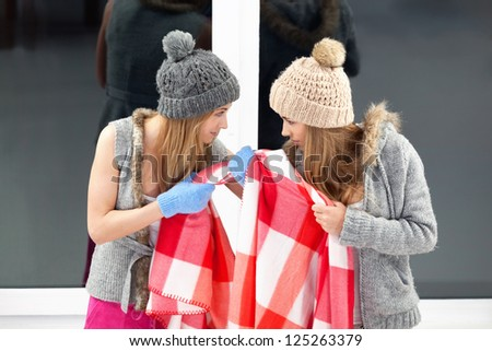 Two girls fighting for blanket - stock photo